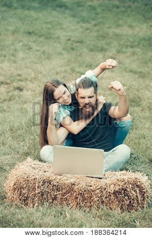 happy couple of student and girl study on laptop in uni on nature or park grass