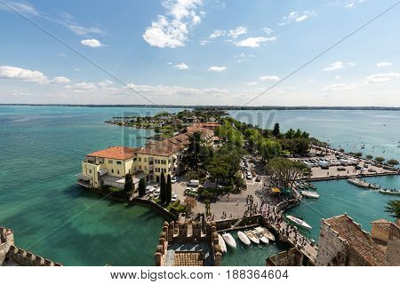 SIRMIONE ITALY - MAY 5 2016: Aerial View of peninsula with Sirmione town from the Scaliger Castle over the Garda Lake Italy