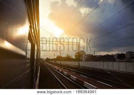 Railway station against the sunny sky. Railway tourism railway tourism. View from the car. Rural industrial landscape. concept