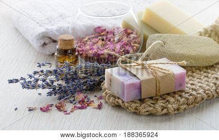 Handmade Lavender an rose Soap with bath and spa accessories. Dried lavender and rose petals with aroma oil