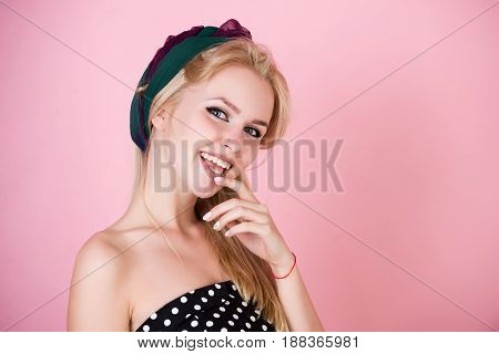 Woman With Hairband On Long, Blond Hair Smiling