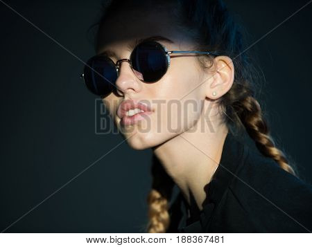Fashion Woman With Adorable Face And Plaits In Stylish Sunglasses