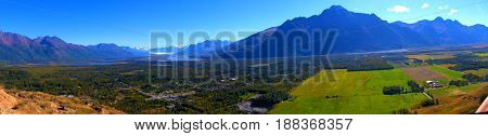 Panoramic view of Pioneer Peak mountains near Palmer Alaska with glacier in the distance.