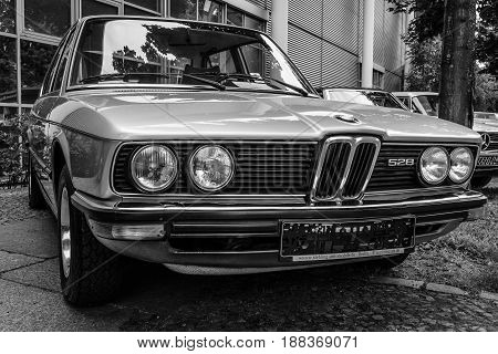 BERLIN GERMANY - MAY 17 2014: Mid-size luxury car BMW 528 (E12). Black and white. 27th Oldtimer Day Berlin - Brandenburg