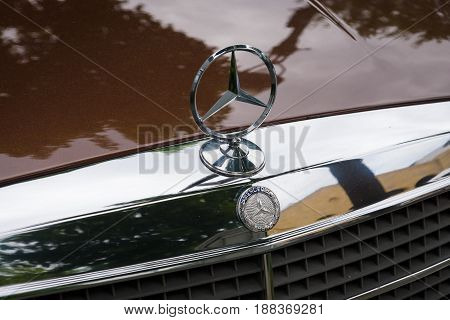 BERLIN GERMANY - MAY 17 2014: Hood ornament of the full-size luxury car Mercedes-Benz 450SEL (W116). 27th Oldtimer Day Berlin - Brandenburg