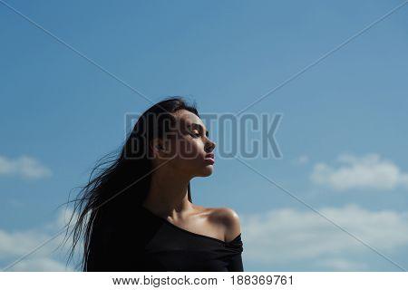 Girl Posing In Black Top With Naked Shoulder
