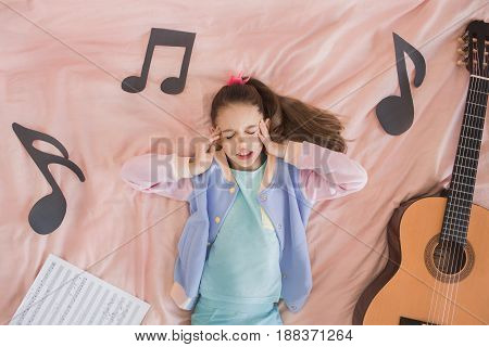 Young teenager girl alone at home childhood guitar
