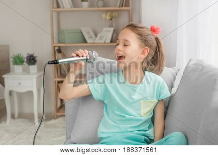 Young teenager girl alone at home childhood singing