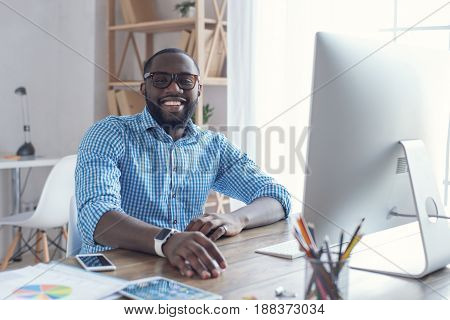 Young african male working in the office business marketer