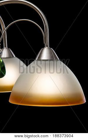 Modern Chandelier for interior decoration of the living room. Chandelier isolated on black background. modern piece of interior for designers.