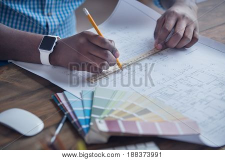 Young african male working in the office business designer