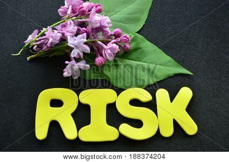 word risk on a abstract black background