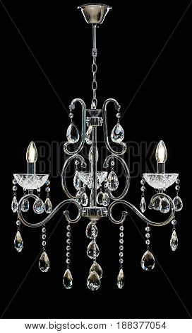 Chandelier for interior of the living room. Large silver crystal chandelier isolated on black background.