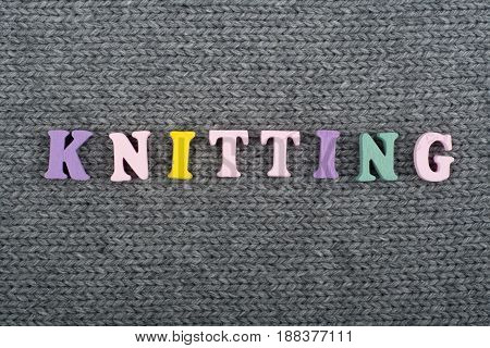 Knitting. Knitted Fabric Texture. Word composed from ABC alphabet letters