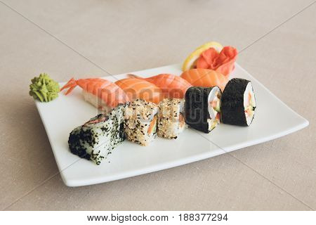 Sushi rolls japanese cuisine set isolated on table