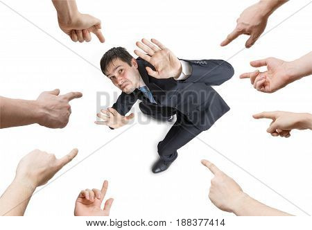 Many Hands Are Pointing And Blame Stressed Man. View From Above.