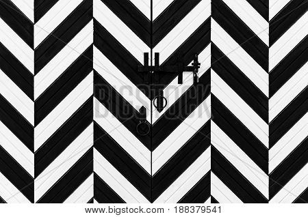 Black and white striped gate with lock