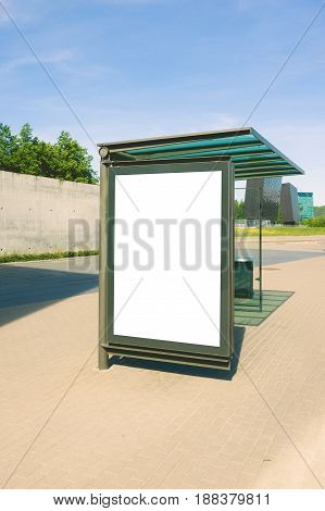 Blank billboard for advertisement, in a bus stop at the street at sunny day