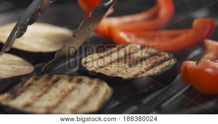 cooking eggplant and pepper on grill pan, wide photo