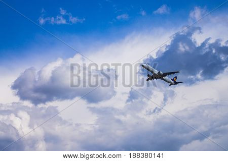 Minsk Minsk National Airport Belarus - May 06 2016: Embraer ERJ-190LR D-AECI Lufthansa CitiLine taking off with background of blue cloudy sky.
