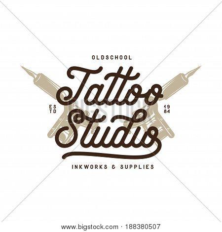 Tattoo studio typography emblem. Hand holding tattoo machine. Vector vintage illustration.