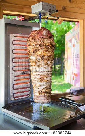 Traditional fast food Turkish doner kebab meat on a rotary grill