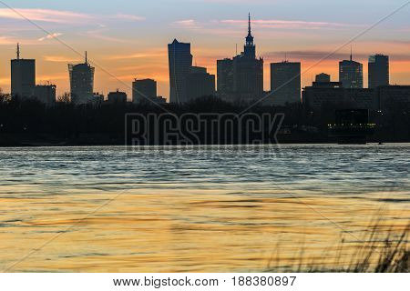 Panorama of Warsaw skyline over Vistula river during sunset