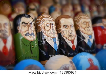 MOSCOW, MAY 26, 2017: World famous politicians cartoon portraits painted on Russian dools matreshka at souvenir market shop. Donald Trump doll, Vladimir Putin doll. Traditional classic handicraft art
