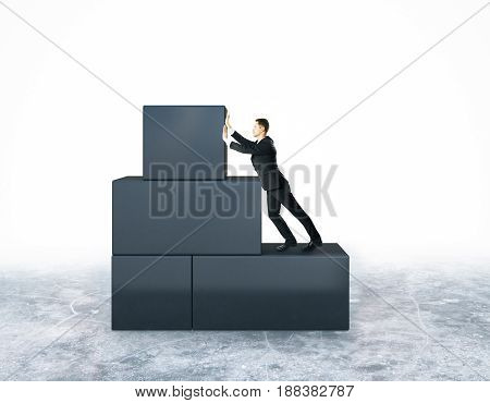 Businessman pushing abstract grey blocks on white background. Stuggle and hard work concept. 3D Rendering