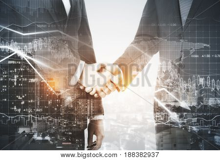Businessmen shaking hands on night city background. Double exposure. Deal concept