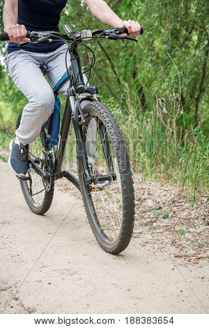 A Trip On A Mountain Bike Along The Forest Path. Sports And The Concept Of Active Life In The Summer