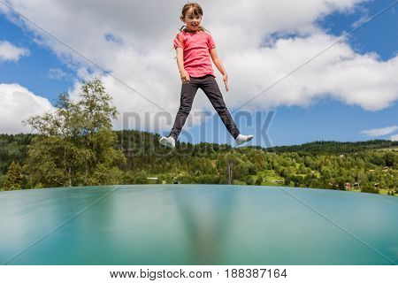 Girl Jumping On Bouncy Pillow