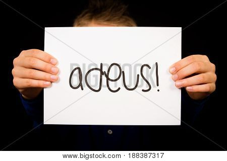 Child Holding Sign With Portuguese Word Adeus - Goodbye