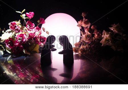 Two Doll Hugging On Table With Flowers And Moon Decoration Lighted Background With Smoke.love Concep