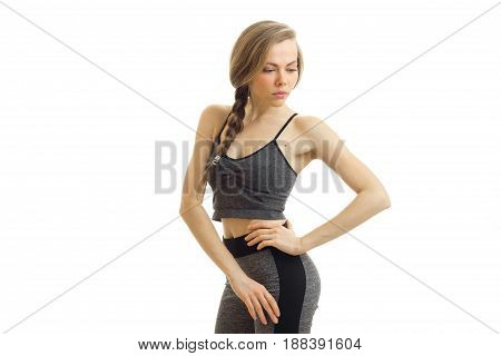 the charming slender girl looks down and keeping his hand on the side of close-up is isolated on a white background
