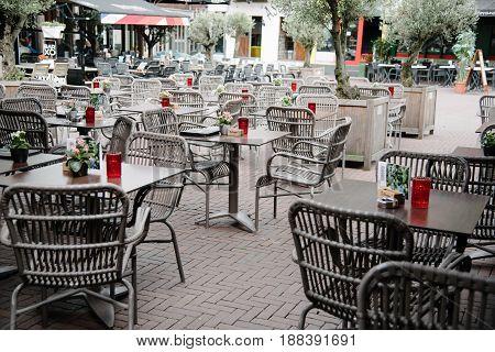 Arnhem Netherlands - August 09 2016: Empty sidewalk cafe in a square in the city of Arnhem in summer time