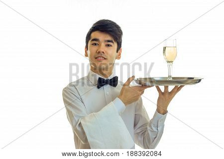 attractive young waiter raised my head up and holding a tray with glasses of champagne close-up isolated on white background