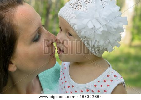Happy mother and little daughter in the park