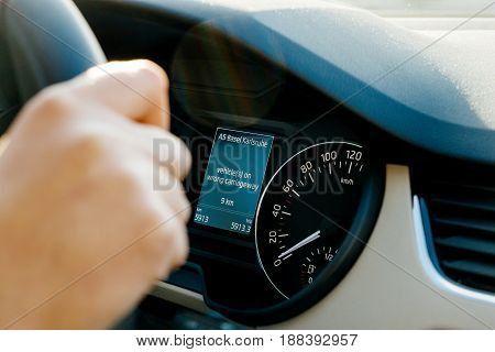 Car computer informing driver vehicle on wrong carriageway near the city of Basel and Karlsruhe - modern communication with the intelligent GPS and DAB announcement for drivers in latest cars