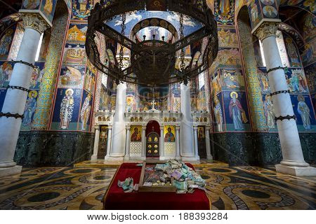 TOPOLA SERBIA - MAY 27 2017: Interior of the Oplenac Royal mausoleum the orthodox church hosting the remains of the Yugoslav Kings of the Karadjordjevic dynasty with an altar full of Serbian dinars in front