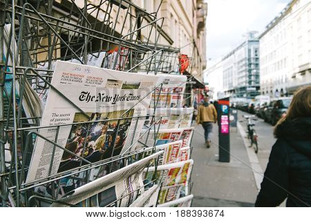 PARIS FRANCE - MAR 23 2017: The Ascent of Paranoia in Politics article about Donald Trump on the main cover of the New York Times at press kiosk newsstand