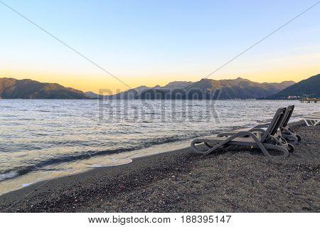 Couple sunbeds during sunset in Marmaris beach Turkey