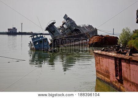 Old rusty sunken ships in Baltiysk bay.