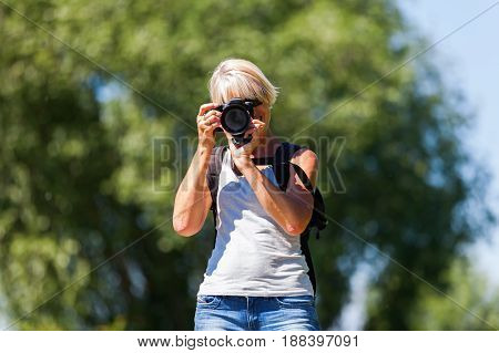 Mature Woman With A Camera