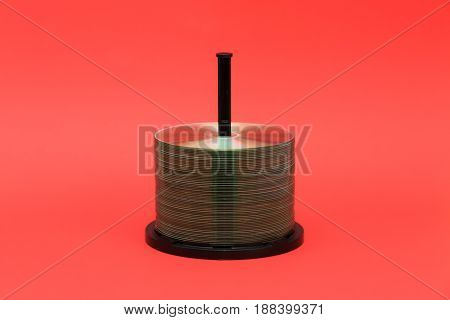 DVD discs and casing with red background. Front view