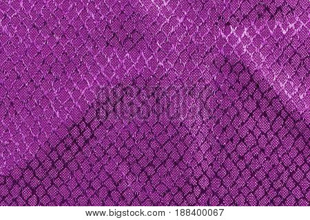 Purple fabric with embossed textures. Top view