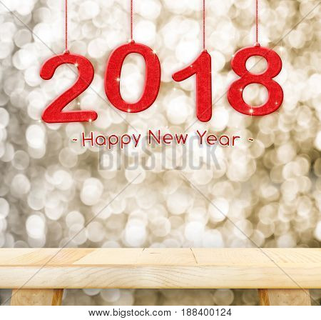 2018(3d rendering) Happy new year hanging over plain wood table top with blur gold sparkling bokeh lightHoliday conceptleave space for adding your design.