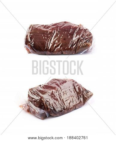 Vacuum packed slice of a beef meat isolated over the white background, set of two different foreshortenings