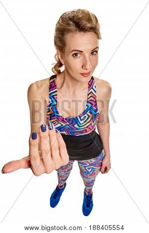 Top view of attractive fitness woman in sportswear showing come here gesture. focus is on her hand.