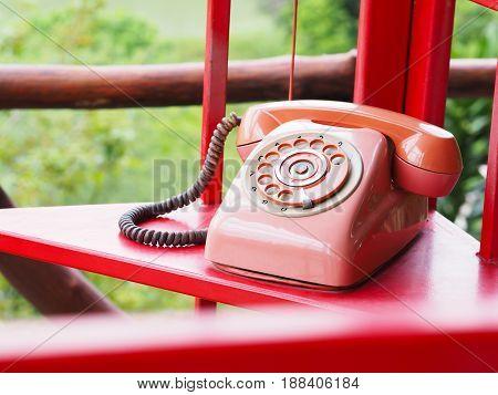close up retro red telephone in telephone box
